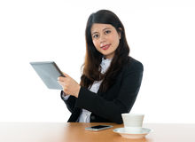 Businesswoman Sitting At Office Desk Royalty Free Stock Photography