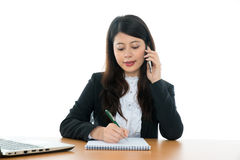 Businesswoman Sitting At Office Desk Royalty Free Stock Photos