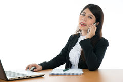 Businesswoman Sitting At Office Desk Stock Photo