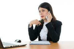 Businesswoman Sitting At Office Desk Royalty Free Stock Photo
