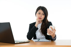 Businesswoman Sitting At Office Desk Stock Photography