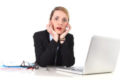 Businesswoman sitting at office desk working with laptop in stress looking upset Stock Photos