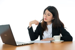 Businesswoman Sitting At Office Desk Royalty Free Stock Image