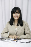 Businesswoman sitting in office Royalty Free Stock Photos