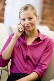 Businesswoman sitting in office space smiling Royalty Free Stock Photo