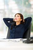 Businesswoman sitting office Stock Photo