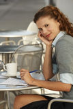 Businesswoman Sitting At Outdoor Cafe. Portrait of young businesswoman sitting at outdoor cafe Royalty Free Stock Image