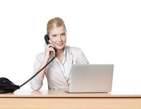 Businesswoman sitting with phone handset Stock Photo