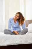 Businesswoman sitting relaxed in hotel room Stock Photo