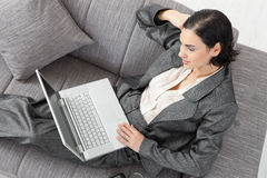 Businesswoman sitting on sofa Stock Image