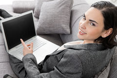 Businesswoman sitting on sofa Stock Photos