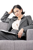 Businesswoman sitting on sofa Stock Photo