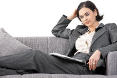 Businesswoman sitting on sofa Royalty Free Stock Images