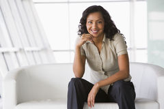 Businesswoman sitting on sofa in lobby Royalty Free Stock Photography