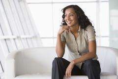 Businesswoman sitting on sofa in lobby Royalty Free Stock Photos