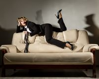 Businesswoman sitting on a sofa in office. stylized retro portrait.  Royalty Free Stock Images