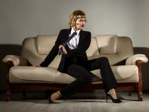 Businesswoman sitting on a sofa in office. stylized retro portrait.  Stock Photos