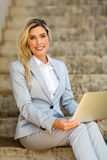 Businesswoman sitting on stairs Royalty Free Stock Image