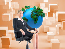 Businesswoman sitting on swivel chair in black suit Royalty Free Stock Photos