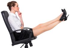 Businesswoman sitting on swivel chair with feet up Stock Photos