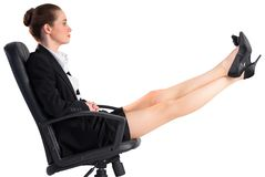 Businesswoman sitting on swivel chair with feet up Stock Images