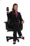 Businesswoman sitting in a swivel chair Royalty Free Stock Photo