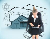 Businesswoman sitting on swivel chair with tablet Stock Photo