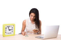 Businesswoman sitting at the table and counting money Stock Photo
