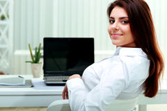 Businesswoman sitting at the table on her workplace Stock Photo