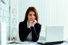 Businesswoman sitting at the table on her workplace Royalty Free Stock Photography