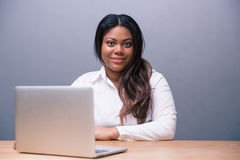 Businesswoman sitting at the table with laptop Royalty Free Stock Image