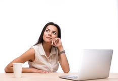 Businesswoman sitting at the table with laptop Royalty Free Stock Photography