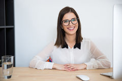 Businesswoman sitting at the table in office Royalty Free Stock Images