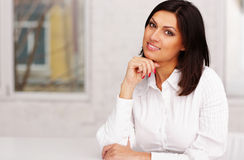businesswoman sitting at the table in office Royalty Free Stock Image
