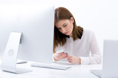 Businesswoman sitting at the table in office Stock Photos