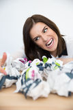 Businesswoman sitting at the table with trash paper Stock Images