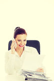 Businesswoman sitting and talking through phone. Stock Photography