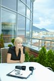 Businesswoman sitting on terrace Royalty Free Stock Photo