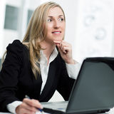 Businesswoman sitting thinking Stock Photography