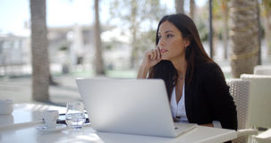 Businesswoman sitting thinking at a restaurant Stock Photography