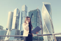 Businesswoman at skyscraper background Stock Image