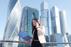 Businesswoman at skyscraper background Royalty Free Stock Images