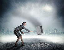 Businesswoman with sledgehammer Royalty Free Stock Image