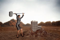 Businesswoman with sledgehammer Stock Image
