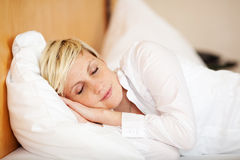 Businesswoman Sleeping On Bed, Eyes Closed Stock Photography