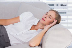 Businesswoman sleeping on couch Royalty Free Stock Photo
