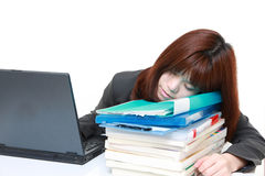 Businesswoman sleeping on the desk Stock Image