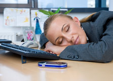 Businesswoman sleeping at her desk Stock Photo