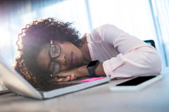 Businesswoman sleeping on her desk Stock Images