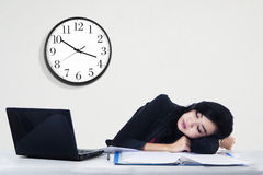 Businesswoman sleeping on her desk Stock Photos